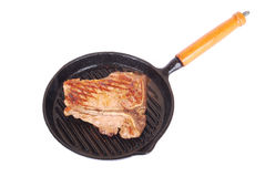 Fried T-bone steak in pan royalty free stock photography