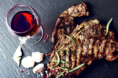 Steak with spices and glass of red wine Stock Image