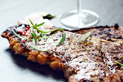Steak with spices and glass of red wine. On stone Stock Photo