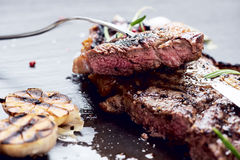 Steak with spices Stock Images