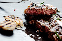 Steak with spices Stock Photography