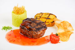Steak with sweet and sour sauce stock photography