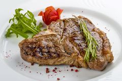 Steak T-bone with greens. royalty free stock images
