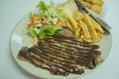 Steak T-bone with salad food and meal Royalty Free Stock Photo