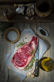 Steak on the table of the kitchen Royalty Free Stock Photos