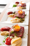 Steak tartar in preparation Stock Photo