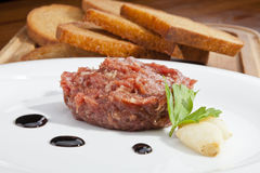 Steak tartar. Ready to eat on the plate Stock Images