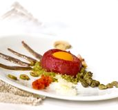 Steak tartare. With egg and other ingredients Royalty Free Stock Photography