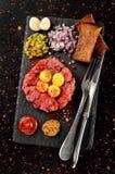 Steak tartare on black stone plate Stock Image