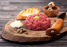 Steak Tartare with capers and fresh onions Royalty Free Stock Photo