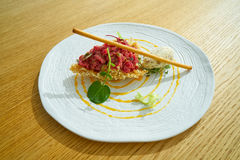 Steak Tartare with mustard ice-cream Royalty Free Stock Image