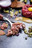 Steak tartare preparation.  Raw ground beef dish Royalty Free Stock Photography