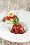Steak tartare and raw egg. Quail egg royalty free stock photography