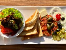 Steak tartare served with side dishes, toast and salad Royalty Free Stock Photos
