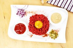 Steak tartare on white plate. Royalty Free Stock Image