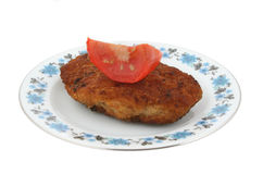 Steak with tomato on a patterned plate Stock Photos