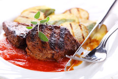Steak with tomato sauce Royalty Free Stock Images