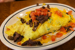 Steak and Tomatoe Omelette Stock Photos