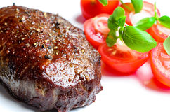 Steak with tomatoes Royalty Free Stock Images