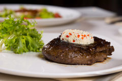 Steak Topped with Herbed Butter on Plate Royalty Free Stock Photography