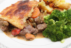 Steak and veg pie stock images