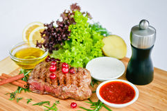 Steak & vegetables Stock Images