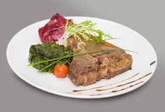 Steak with vegetables. On grey background Stock Photo