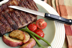 Steak and vegetables Stock Photos