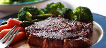 Steak with vegetables closeup Stock Photography