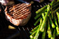 Steak and vegetables on grill macro Stock Photography