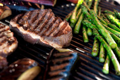 Steak and vegetables on grill Royalty Free Stock Photo