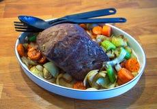 Steak. With vegetables on an oak desk Stock Photos