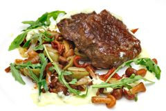 Steak with vegetables on the plate Royalty Free Stock Photos
