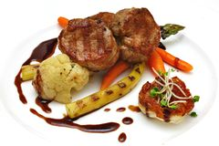Steak with vegetables on the plate Stock Images