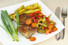 Steak with vegetables and potatoes. Stock Image