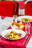 Steak and vegetables on a restaurant table Stock Photo