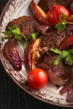 Steak with vegetables stock images