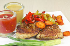 Steak with vegetables and sauces. Royalty Free Stock Image
