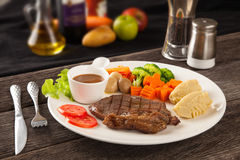 Steak with vegetables and spices Royalty Free Stock Image
