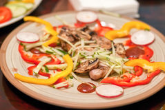 Steak with vegetables on a white plate royalty free stock photography