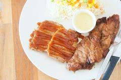Steak in white disk soft light Royalty Free Stock Images