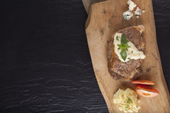 Steak and white sauce Royalty Free Stock Images