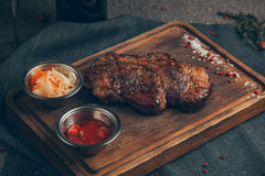 Steak. On wood background. Russia, Yekaterinburg stock images