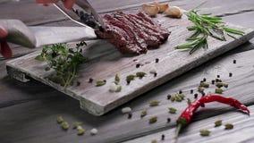 Steak on a wooden board. stock footage