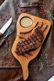 Steak on a wooden board stock photos