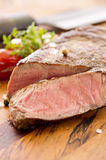 Steak on Wooden Plate Royalty Free Stock Images