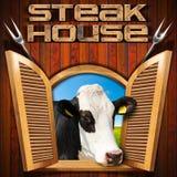 Steakhouse - okno z krową Zdjęcie Royalty Free