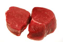 Steaks. Two prime filet mignon steaks ready for grilling isolated on white royalty free stock photography