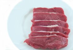 Steaks. Fillets of veal on a white background Stock Photography