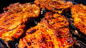 Steaks on barbecue. Meat preparing on grill . to cook food on fire stock photo